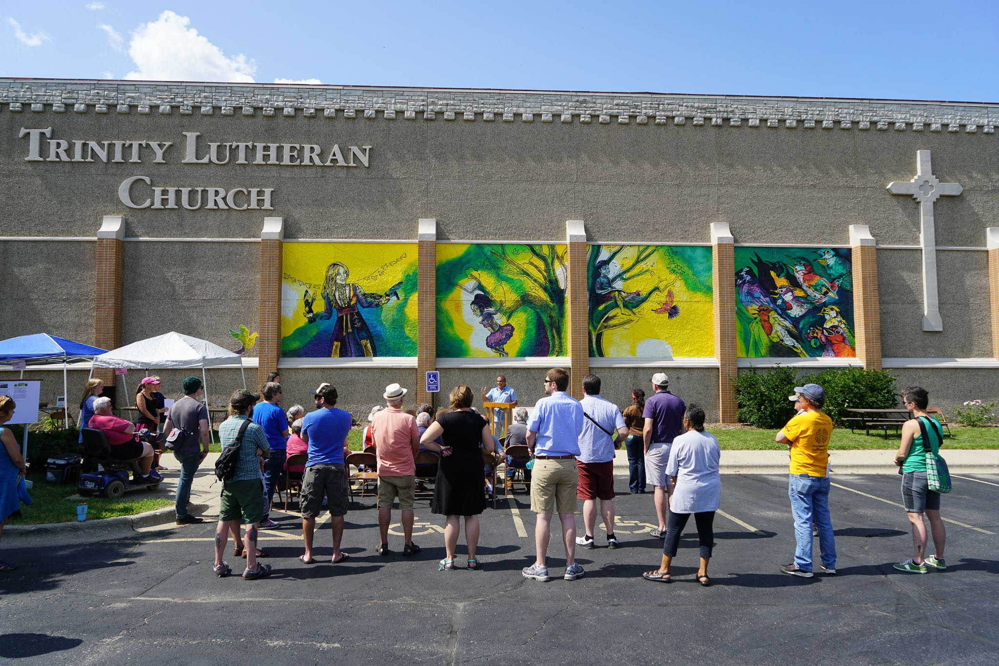 Giant Mural at Lutheran Church with Crowd